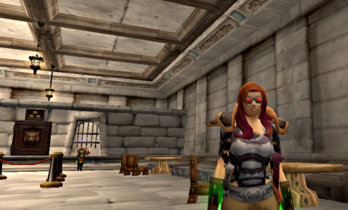 Checking in on her Guild Bank, Waylan pauses at the Stormwind Bank